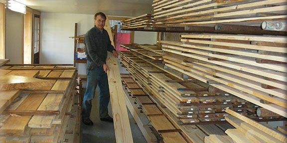 Stacking lumber in a storage room